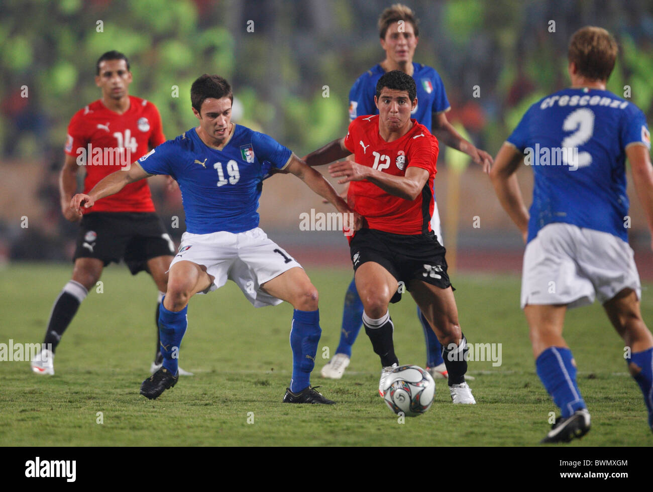 Marco Romizi of Italy (19) and Islam Ramadan of Egypt (12) vie for the ball during a 2009 FIFA U-20 World Cup Group - Stock Image