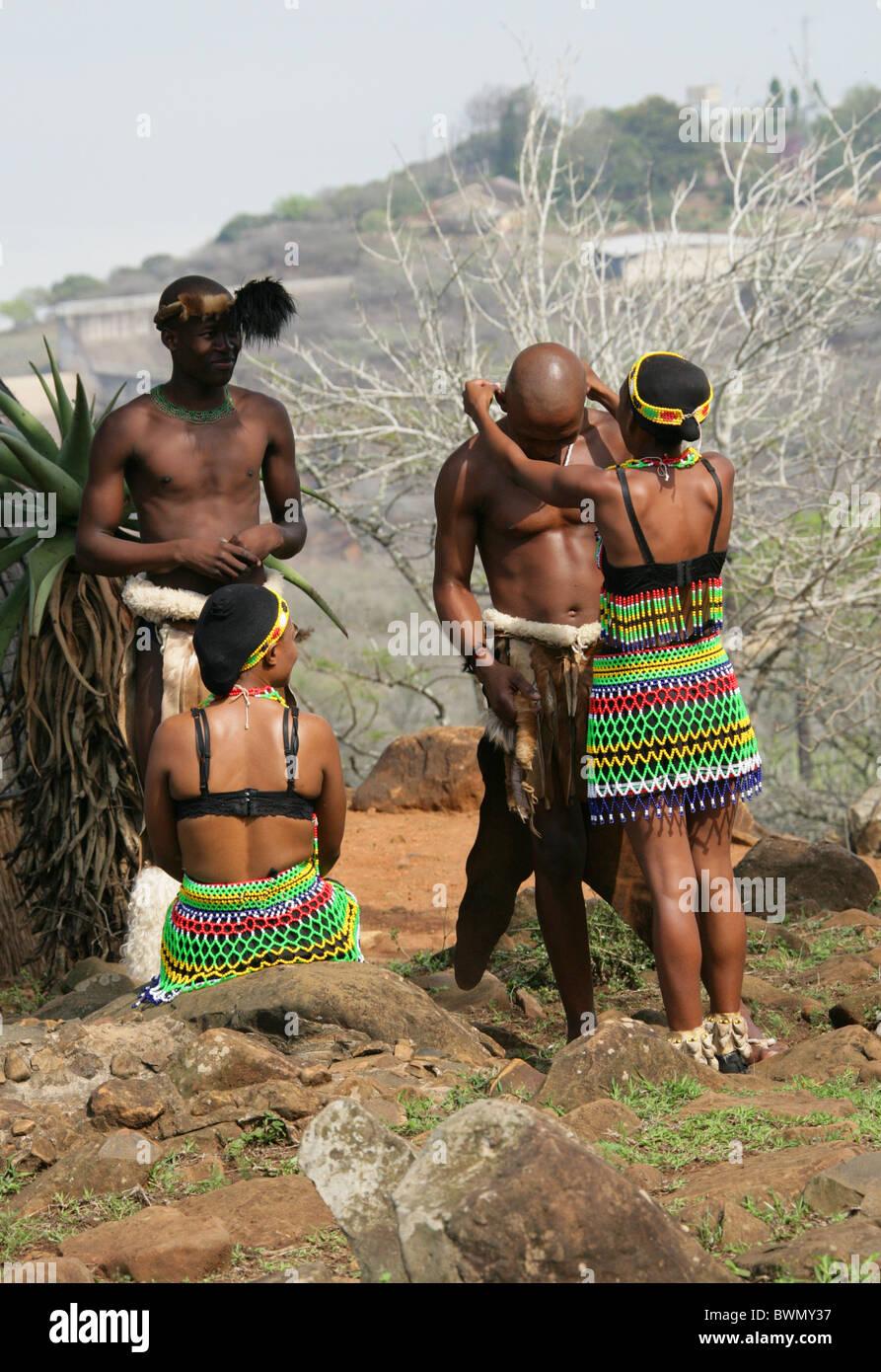 Young Zulu Maiden Giving a Zulu Warrior a Betrothal Necklace, Shakaland Zulu Village, Nkwalini Valley, Kwazulu Natal, - Stock Image
