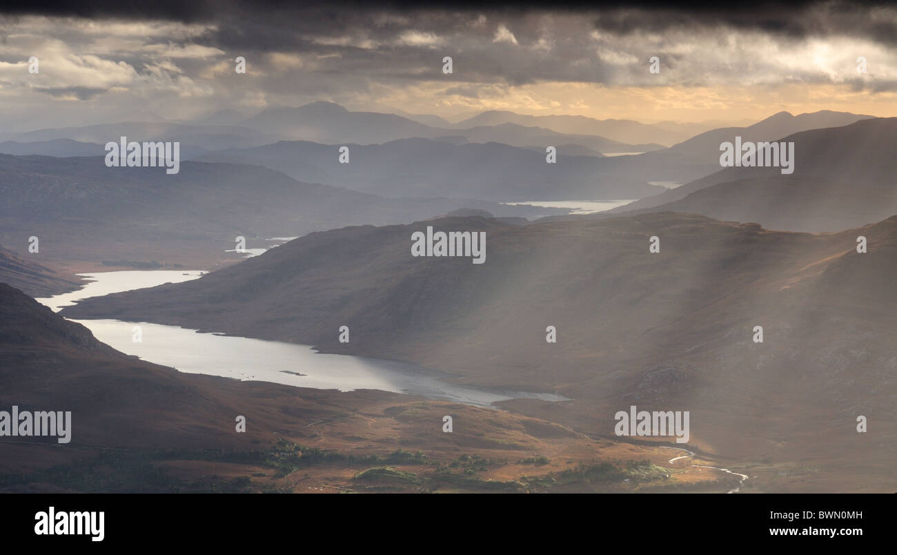 Rays of sunlight over lochs and mountains in Torridon, Wester Ross, north west Highlands of Scotland - Stock Image