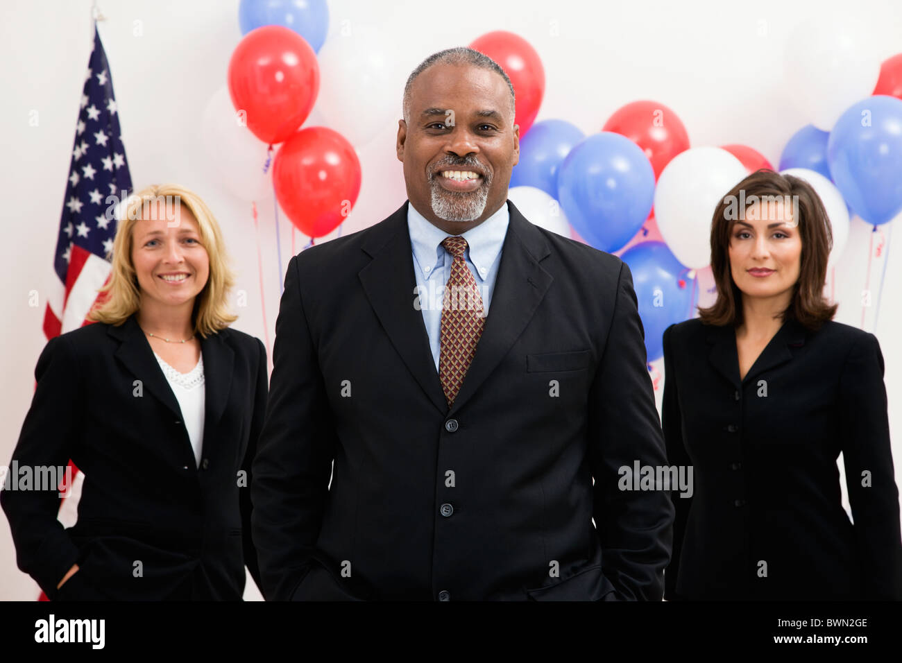 USA, Illinois, Metamora, Portrait of politicians in front of US flag and balloons - Stock Image