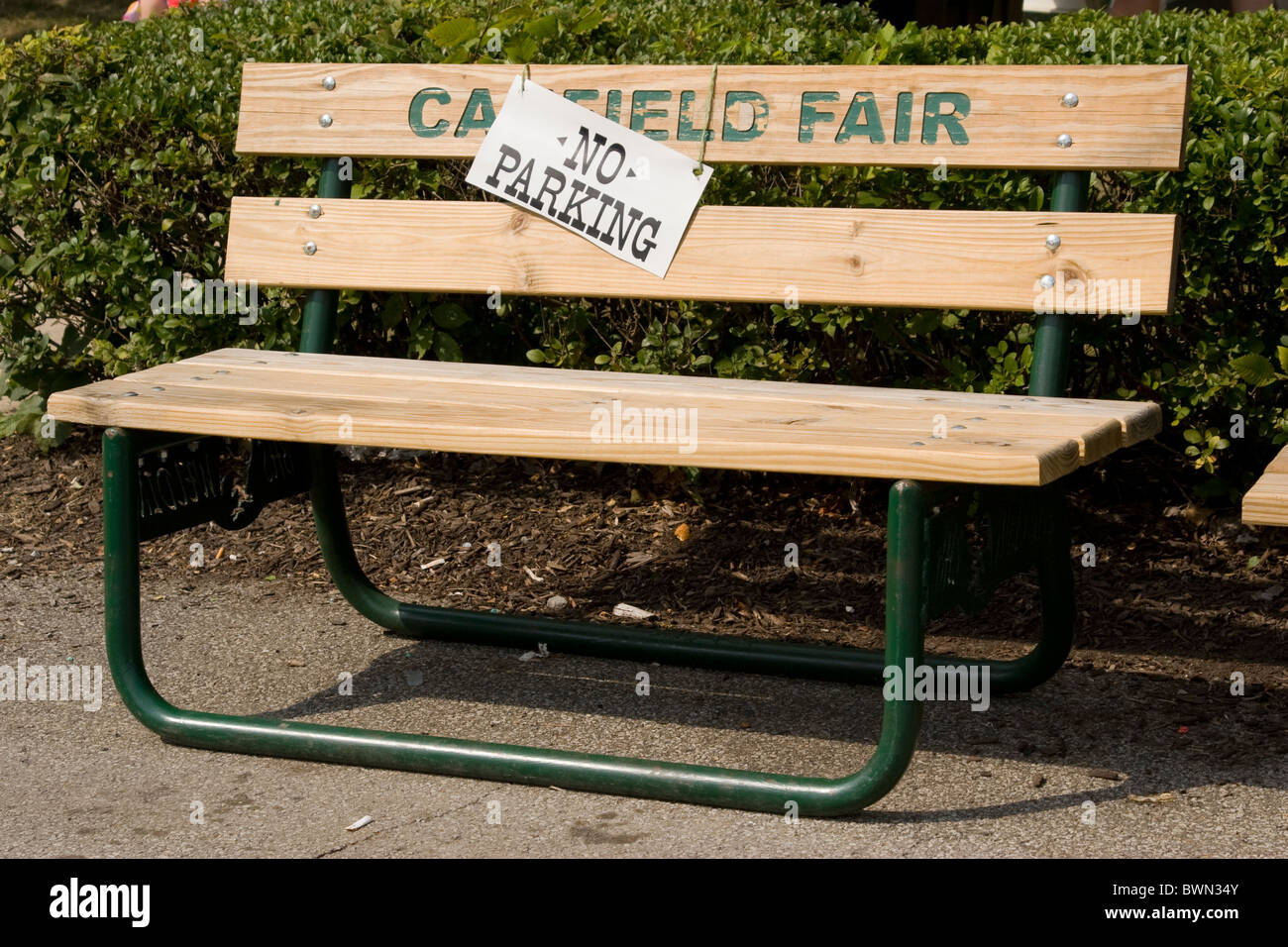No Parking sign on park bench at Canfield Fair, Mahoning County Fair, Canfield, Ohio, USA. - Stock Image