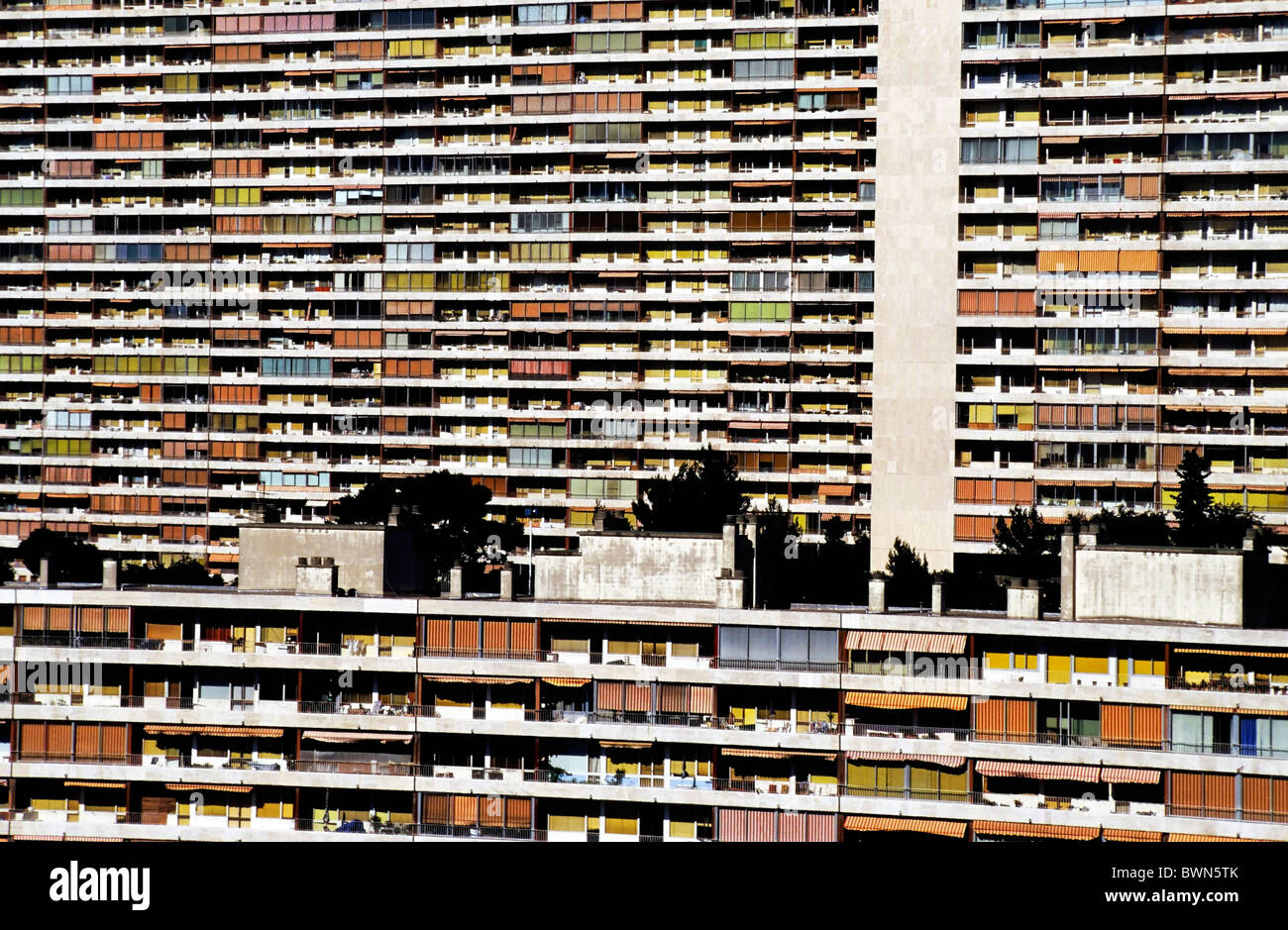 French apartment buildings with balconies with colourful sun shades, in the city centre of Marseille, France - Stock Image