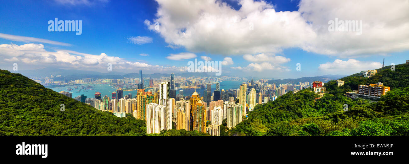The Peak is Hong Kong's premier visitor attraction, providing Victoria harbour and city views. Panorama panoramic - Stock Image