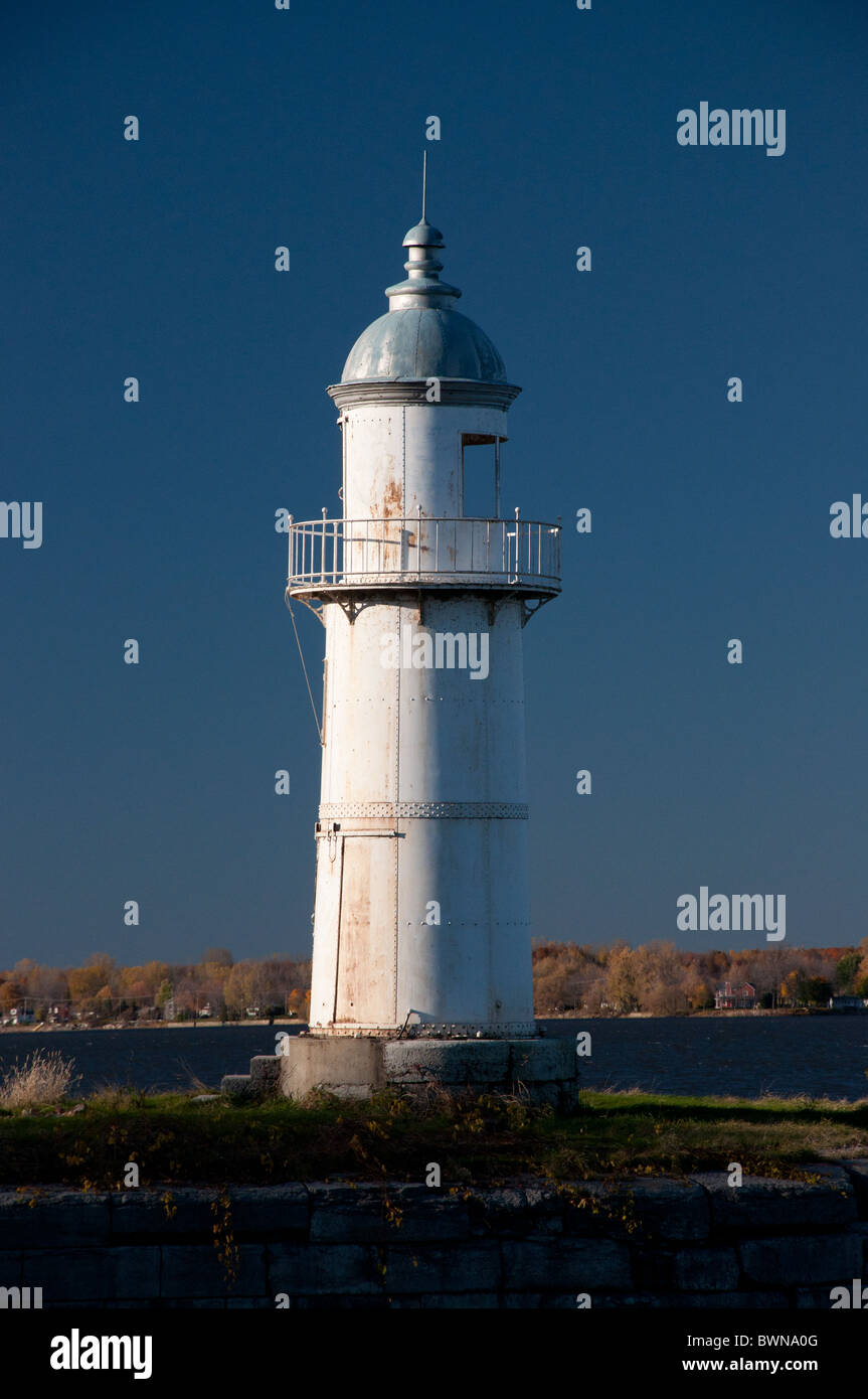 An historical lighthouse at the entrance to the Soulange canal. - Stock Image