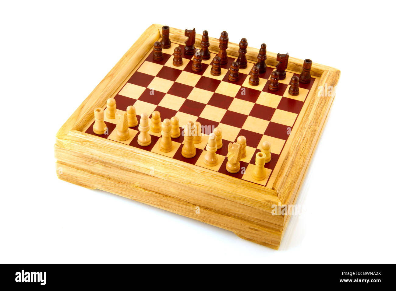 Playing chess with wooden game isolated over white - Stock Photo