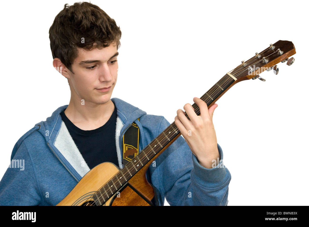 Teenager playing acoustic guitar on white background - Stock Image