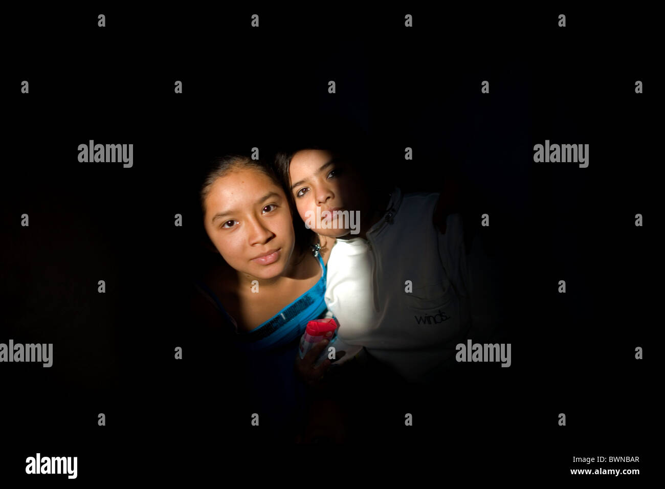 Two young girls pose in a shelter for chronically ill children run by the San Judas Tadeo Foundation in Mexico City, Mexico. Stock Photo