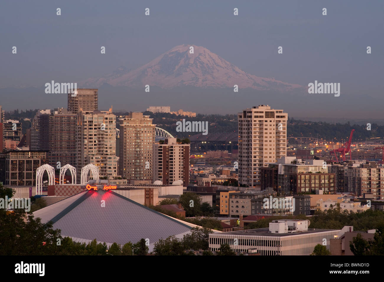 Seattle downtown with Mount Rainier and city lights Seattle Washington State USA - Stock Image