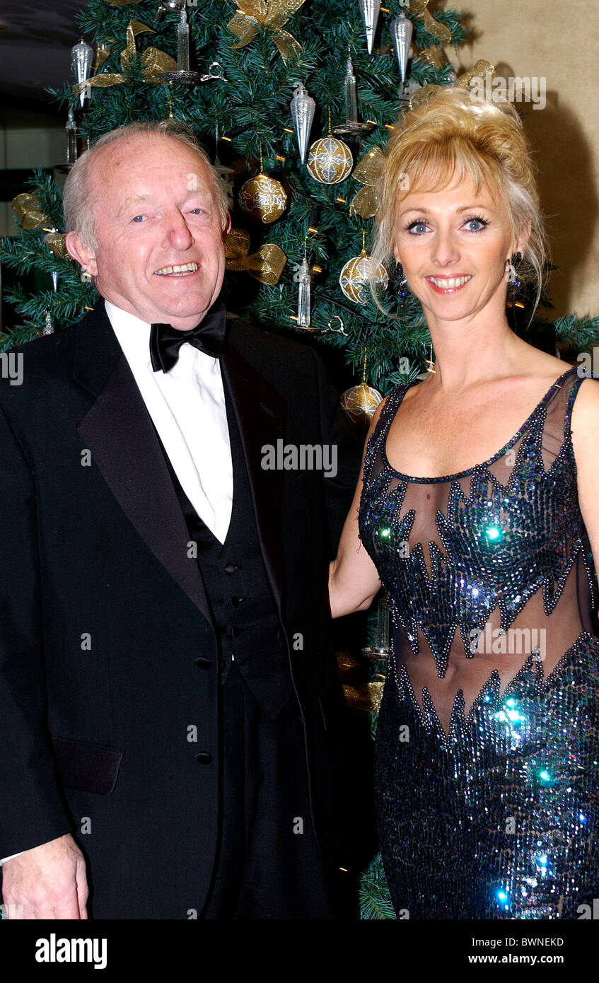 Paul Daniels, illusionist and magician, with wife Debbie McGee at Christmas time fundraising event for the SPARKS - Stock Image