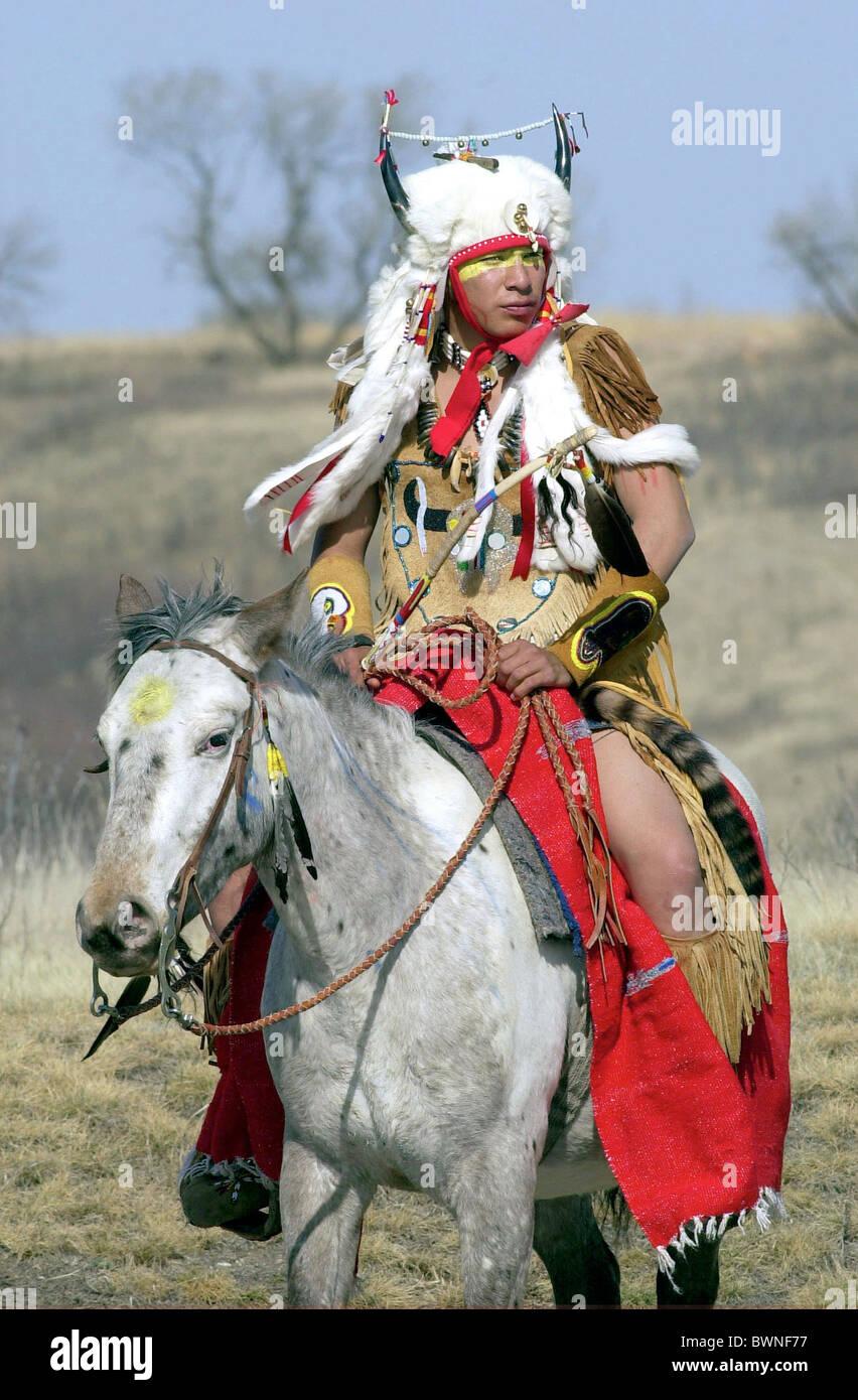 CANADIAN PLAINS IndiaN ON HORSEBACK AT WANUSKEWIN HERITAGE PARK, SASKATOON, CANADA - Stock Image