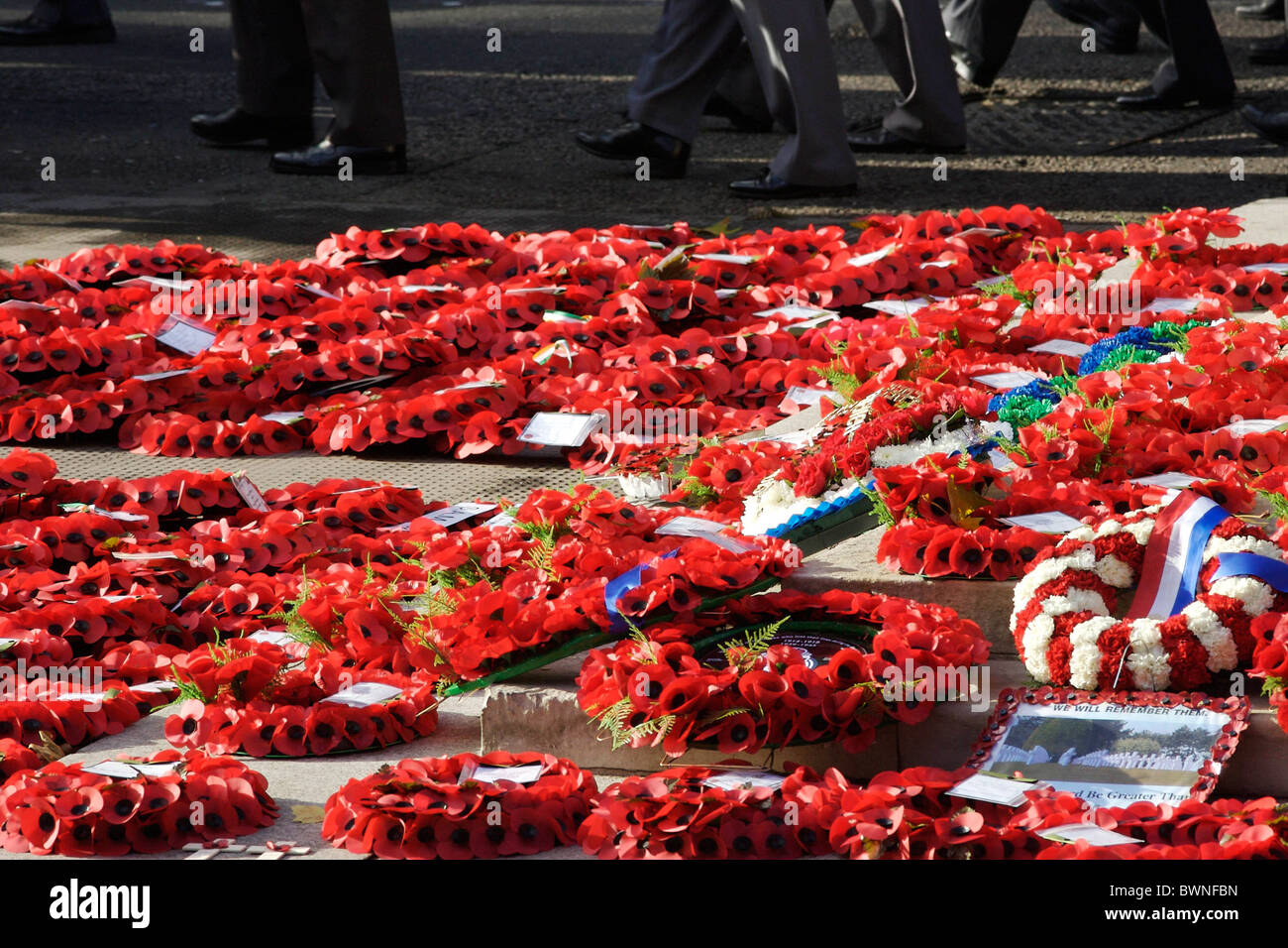 Veterans march past wreaths at the Cenotaph in Whitehall on Remembrance Sunday to commemorate the war dead - Stock Image