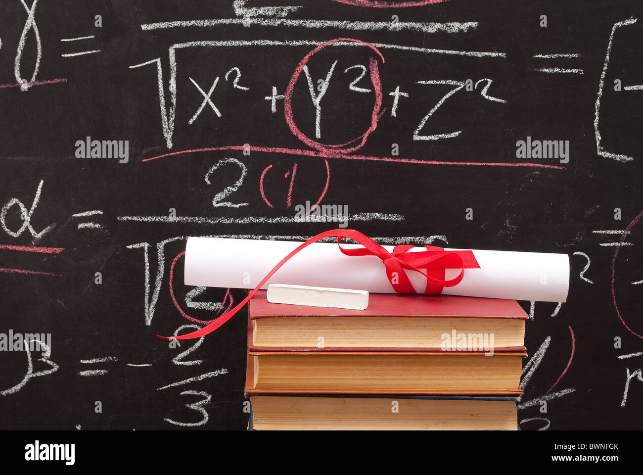 Chalkboard with a diploma and books - Stock Image