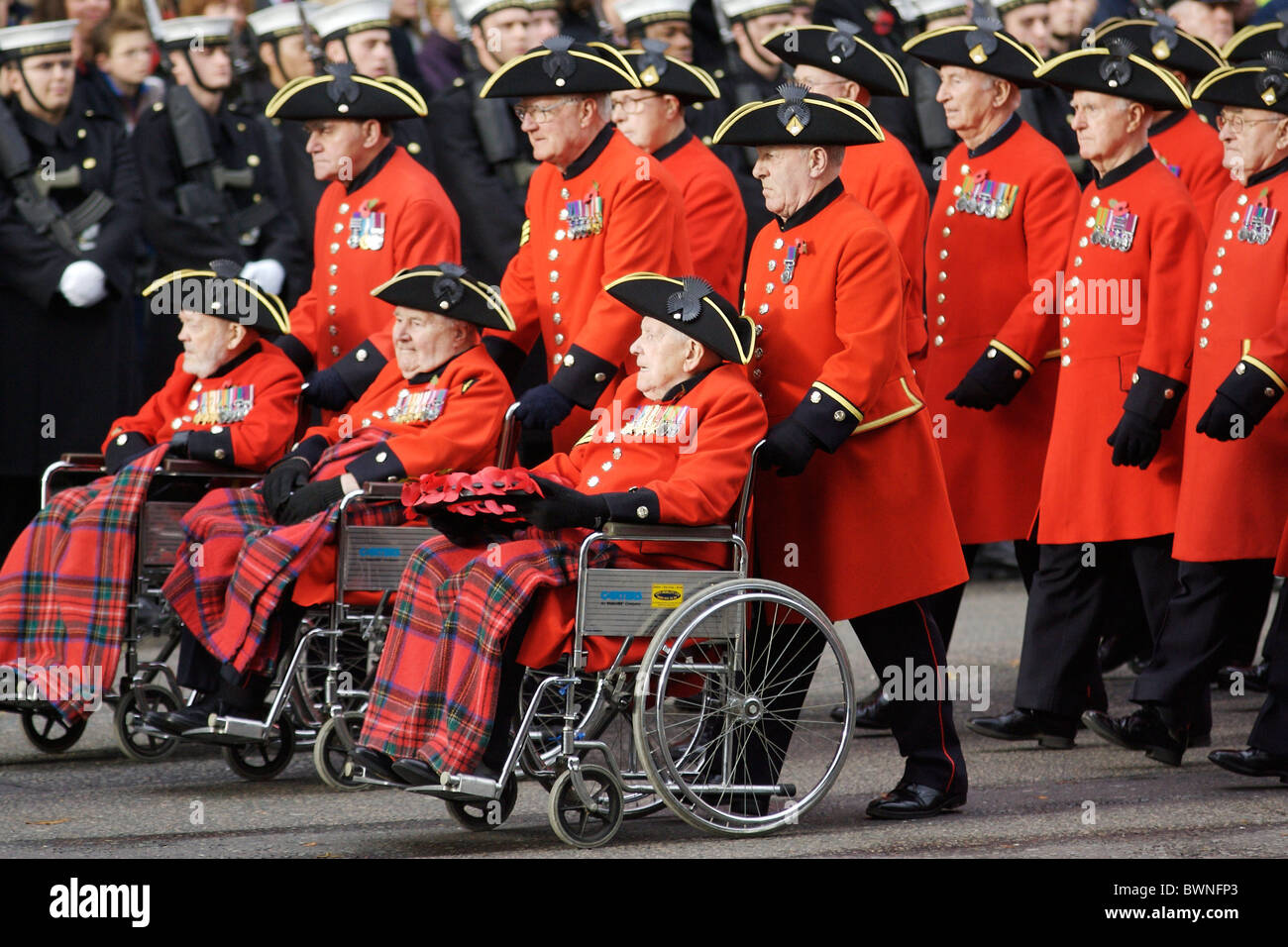 Chelsea Pensioners Veterans march past at the Cenotaph in Whitehall on Remembrance Sunday to commemorate the war - Stock Image