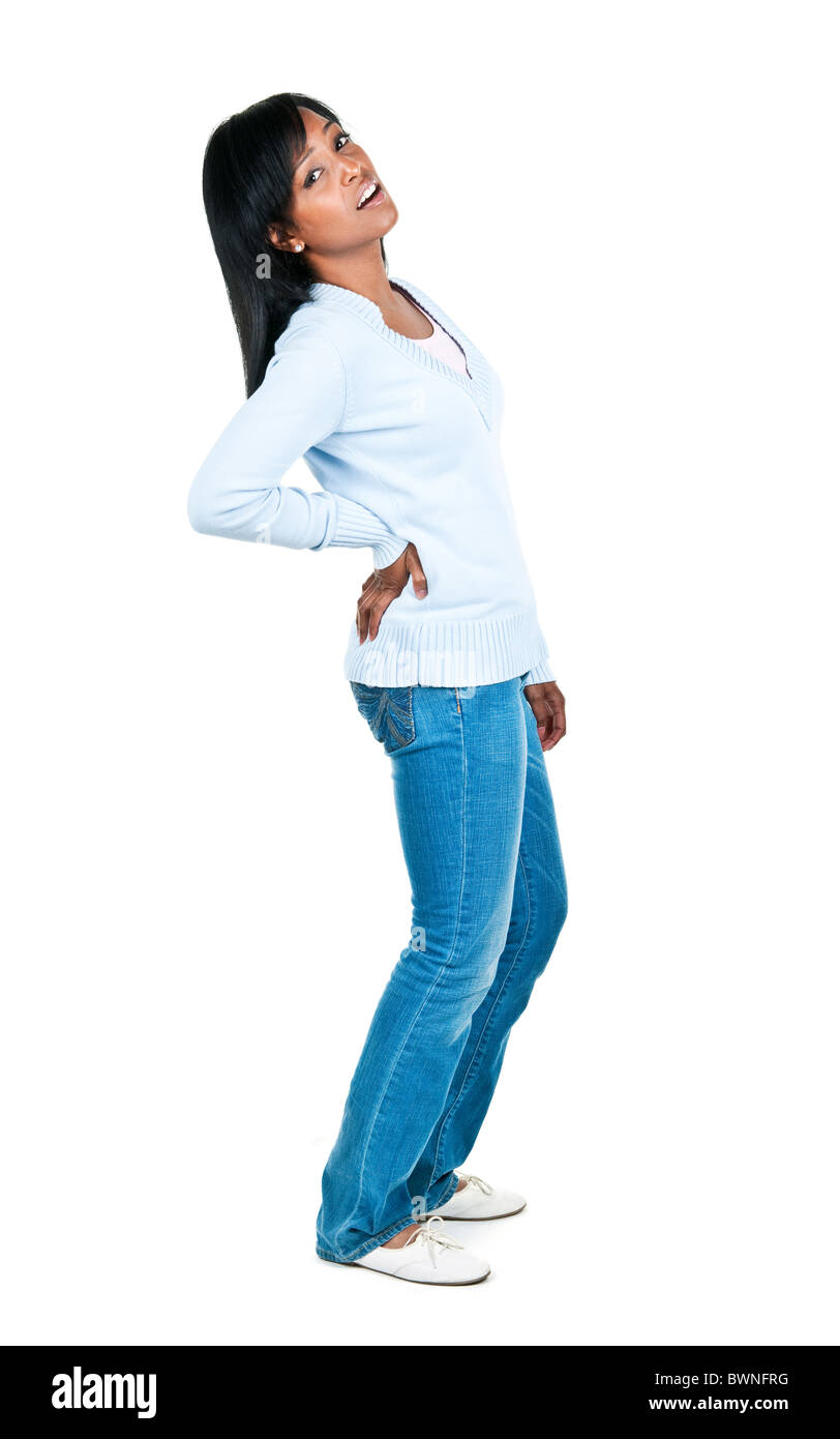 Black woman with back pain standing isolated on white background - Stock Image