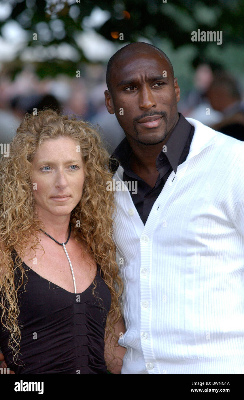 Footballer Sol Campbell with girlfriend, Kelly Hoppen, at a celebrity summer party in Chelsea, London - Stock Image