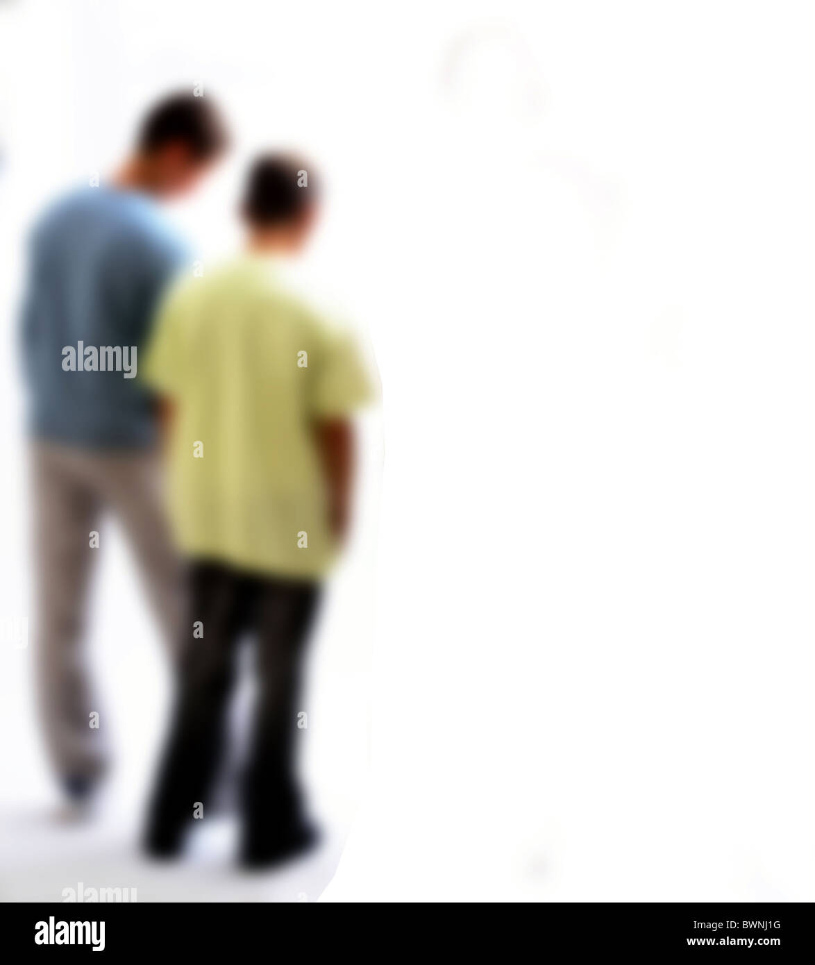 Back view of two teenage boys, back view soft focus. - Stock Image