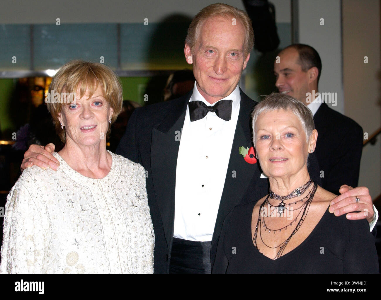 Charles Dance director of 'Ladies in Lavender' with actresses Dame Maggie Smith and Dame Judi Dench in London Stock Photo