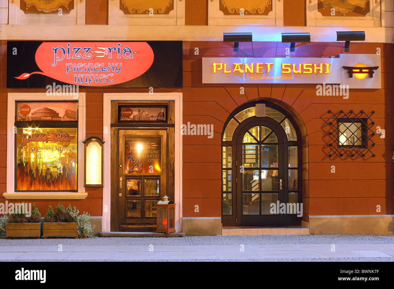 Planet Sushi restaurant by night Wroclaw Old Market Poland - Stock Image