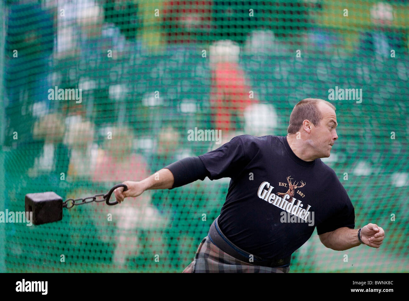 Test of strength Throwing the Hammer at the Braemar Games Highland gathering, SCOTLAND - Stock Image