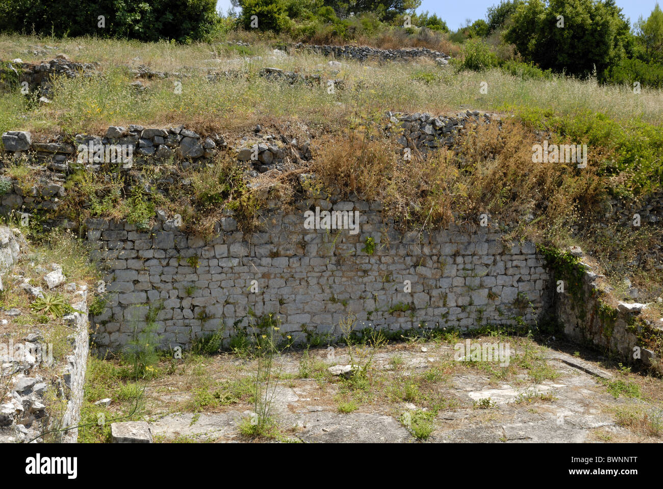 A fine view to the ruins of the Roman Villa on the hill of the peninsula of RAT in Cavtat Town. The construction - Stock Image