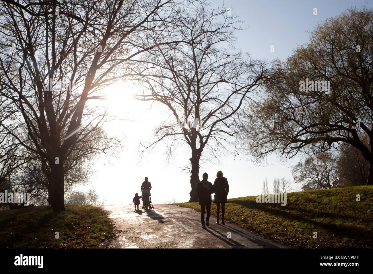 Hampstead Heath. People walking amongst autumn trees. London, England, UK - Stock Image