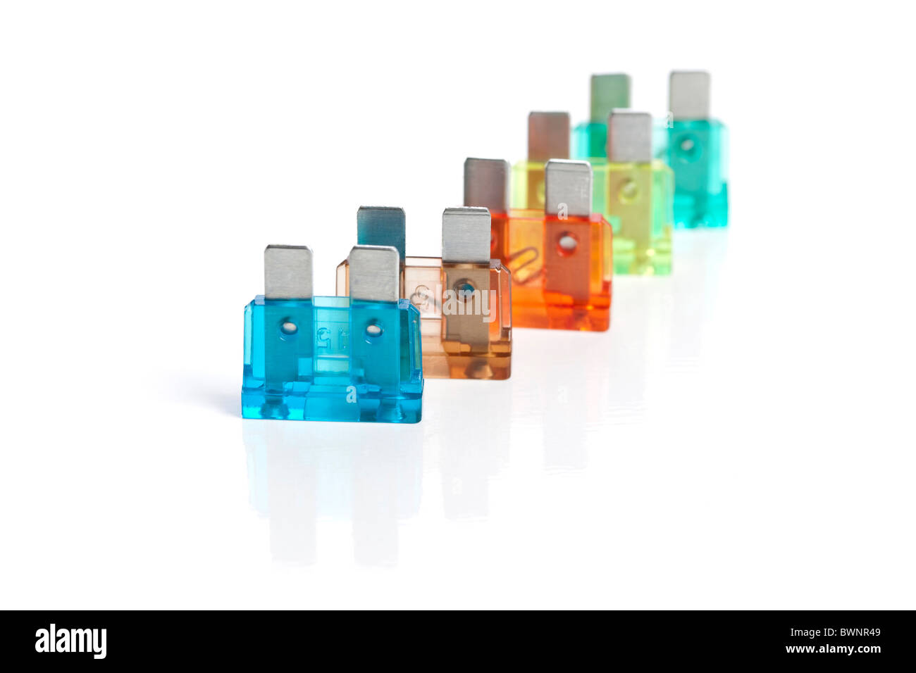 Electric fuses on white background - Stock Image