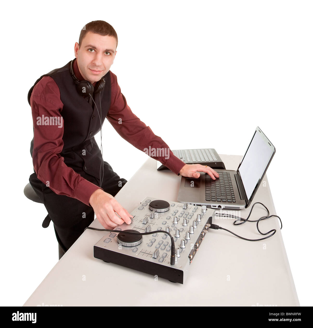 A disc jockey looking at the camera isolated on white. - Stock Image
