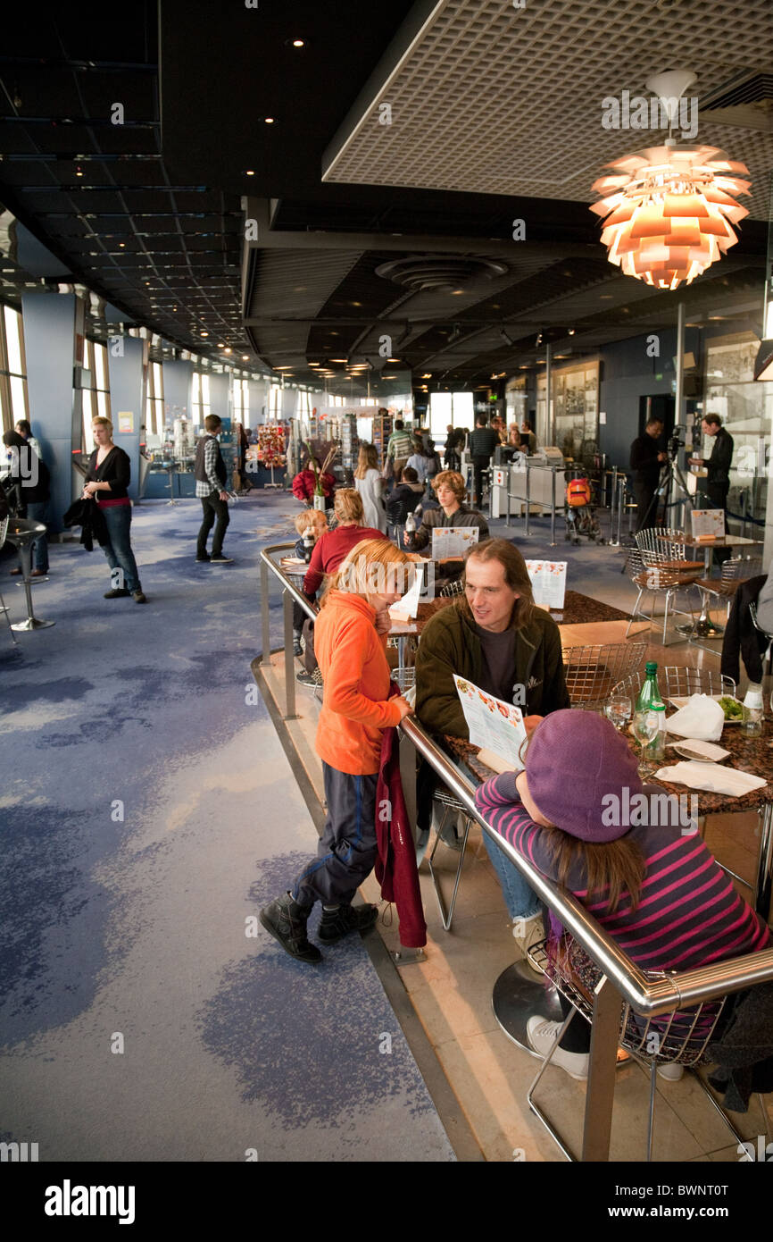 People eating and drinking at the 360 degree cafe on the 56th floor of the Montparnasse Tower, Paris, France - Stock Image