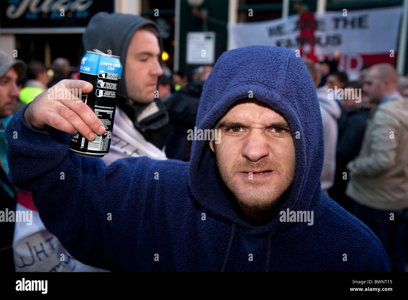 English Defence League EDL member with can of lager glaring and snarling at an anti islamic protest march in preston - Stock Image