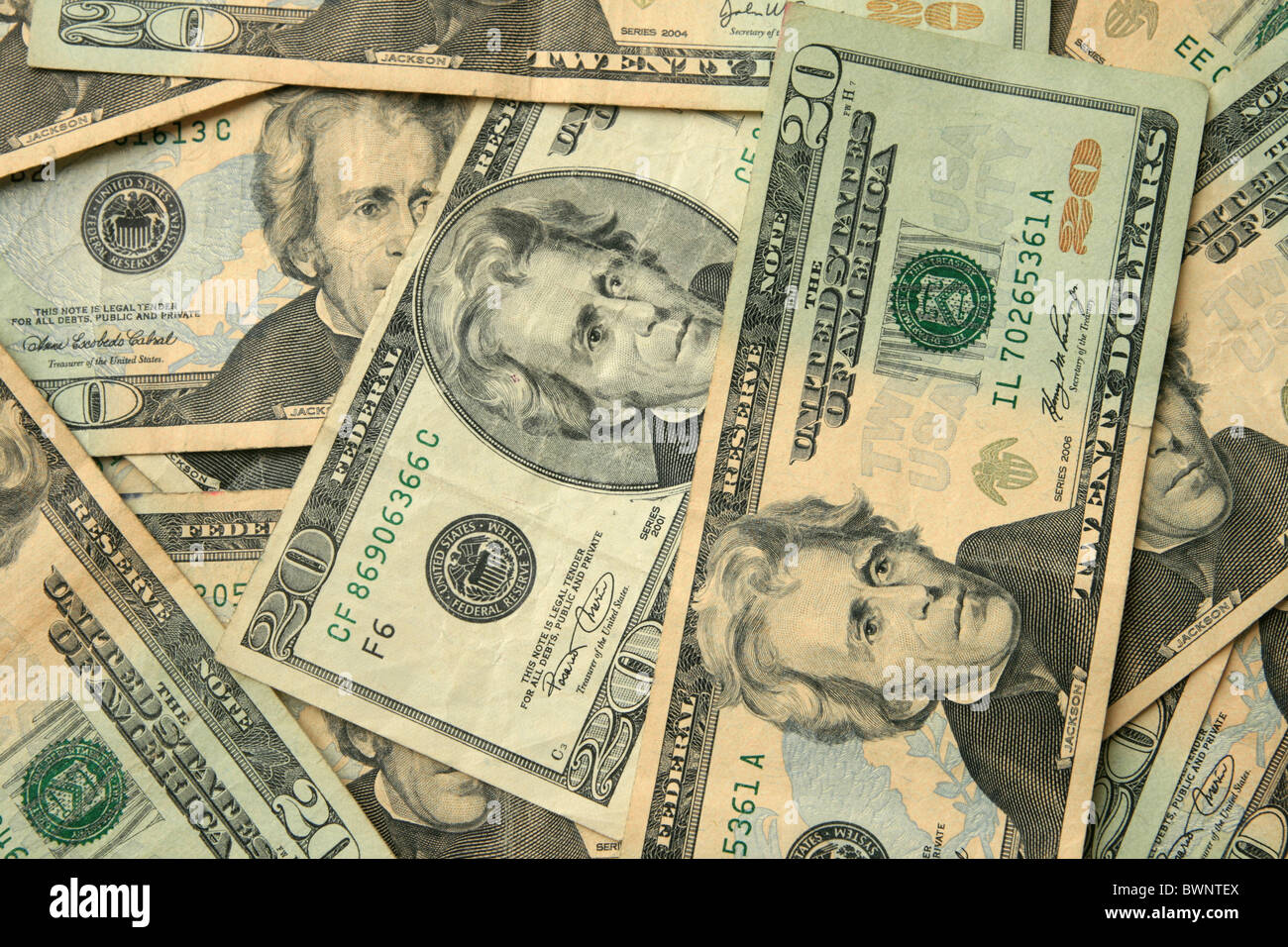 a number of twenty dollar US bills in a background - Stock Image