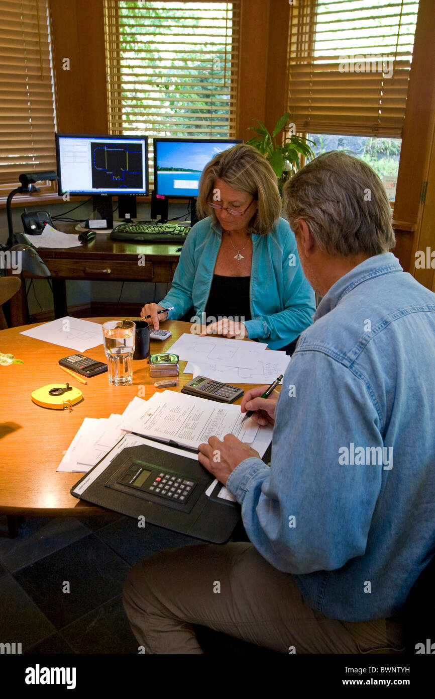 Professional energy auditor meets with a homeowner in a home for a home energy audit, energy efficiency. - Stock Image