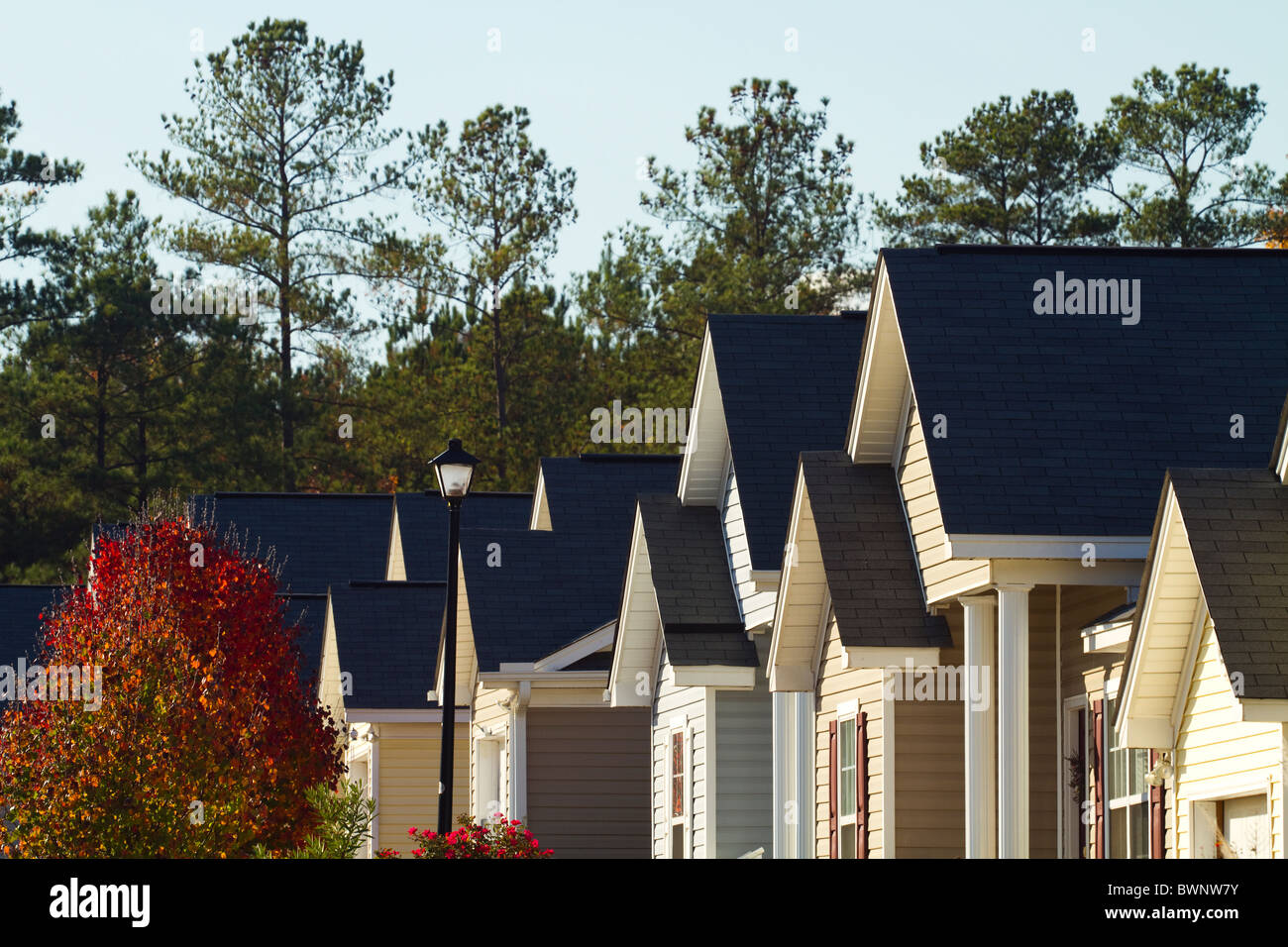 Pointed rooflines of typical middle class, southern American residential subdivision of homes that are built close Stock Photo