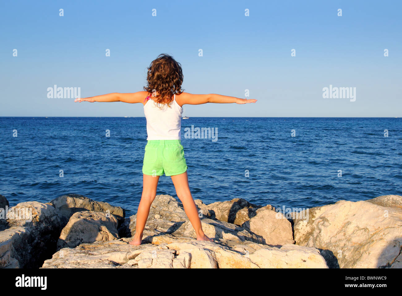open arms girl looking blue ocean sea feeling freedom in vacation - Stock Image