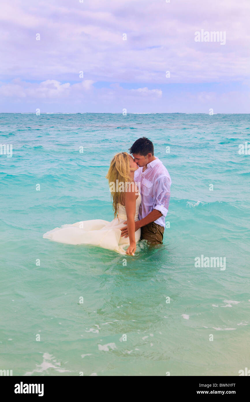 newly wed couple in the ocean at Lanikai, Hawaii - Stock Image