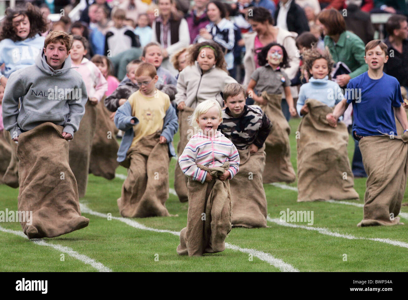 The traditional children's sack race at the Braemar Games Highland gathering - Stock Image