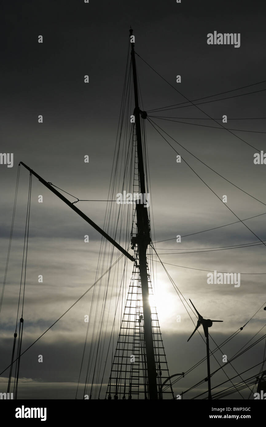 "Modern wind turbine and mast of the Royal Research Ship ""Discovery"" . Dundee, Tayside, Scotland. Stock Photo"