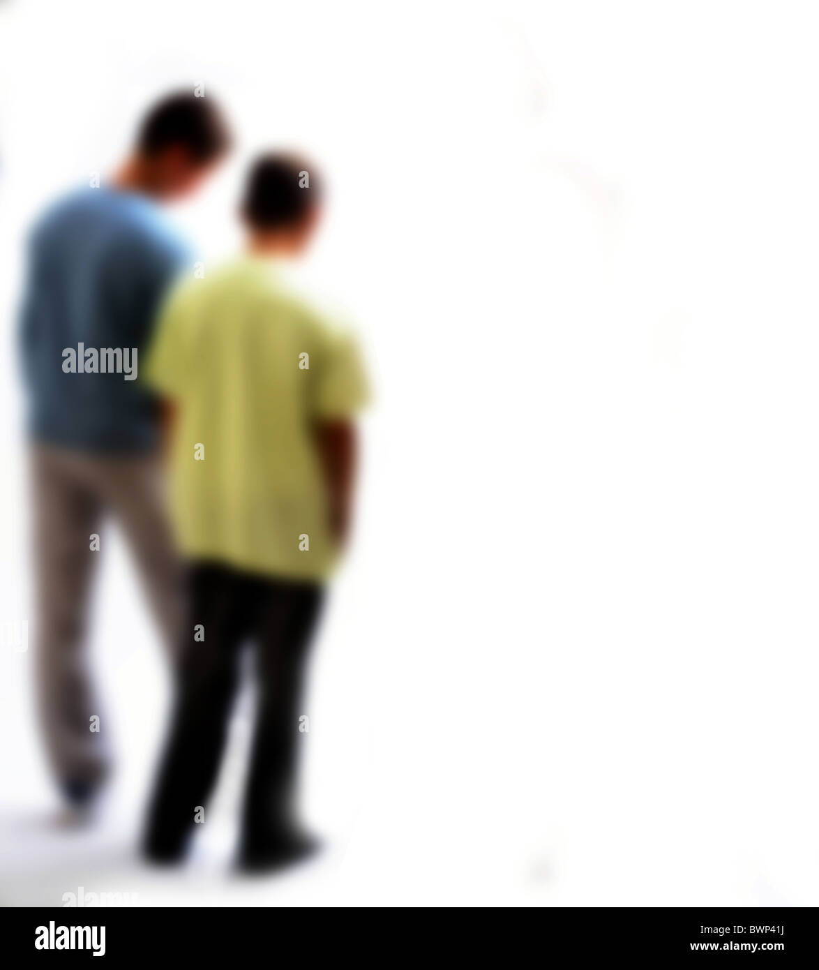 Back view of two young boys between around 10 -14 years old, back view soft focus. - Stock Image