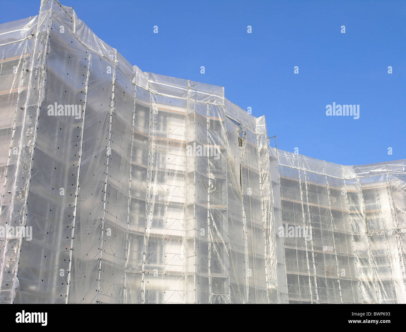 Construction site Building Scaffolding Scaffold Sheeting Structure Industry Real estate Buildings - Stock Image