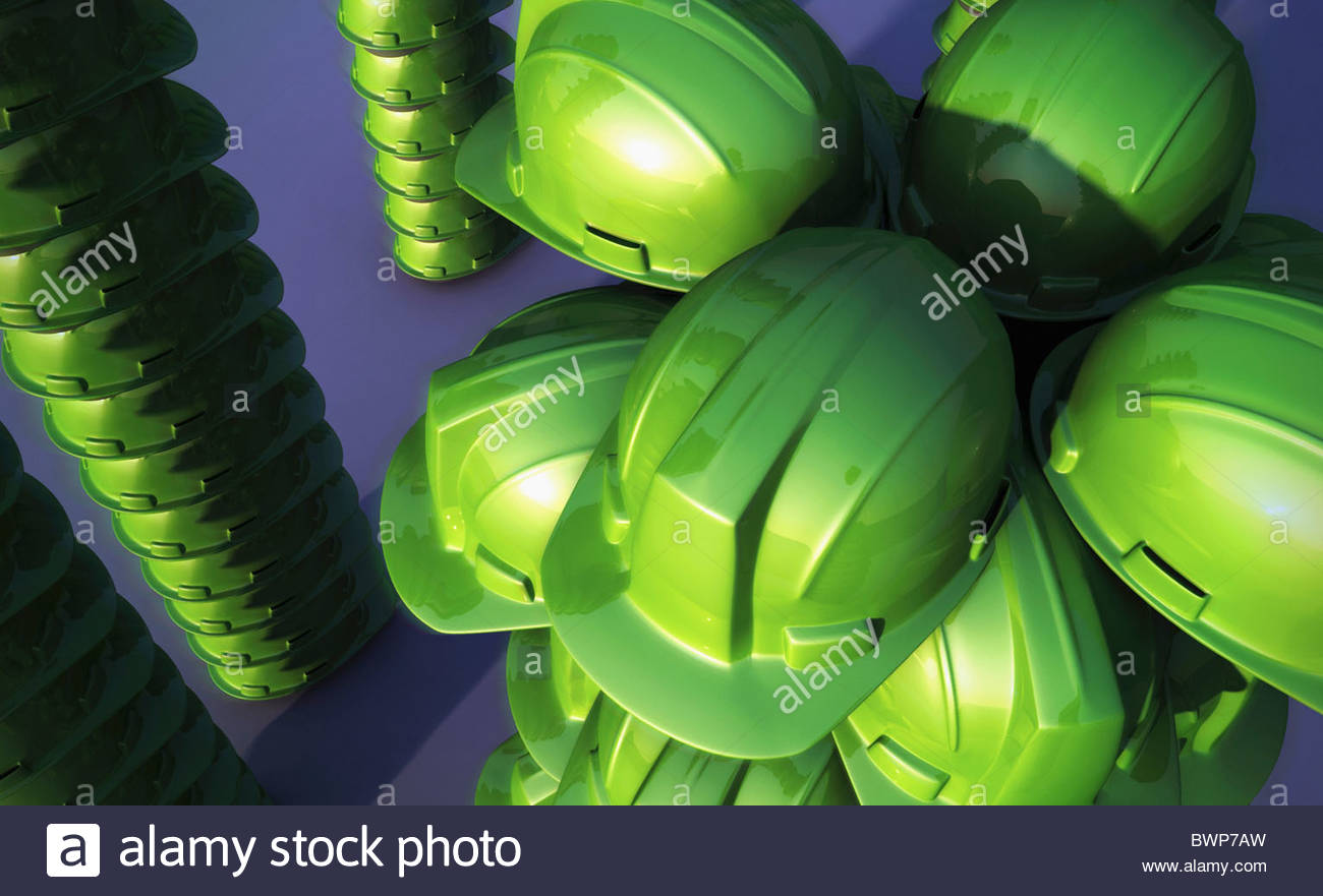Green hard-hats in formation - Stock Image