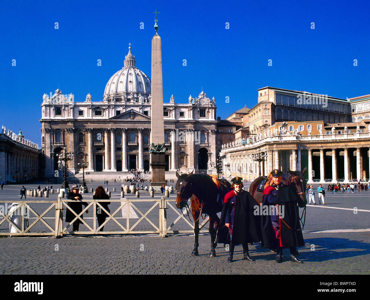 Vatican city January 2007 Europe St. Peter Square St. Peter Basilica police horses tourists UNESCO World heri - Stock Image