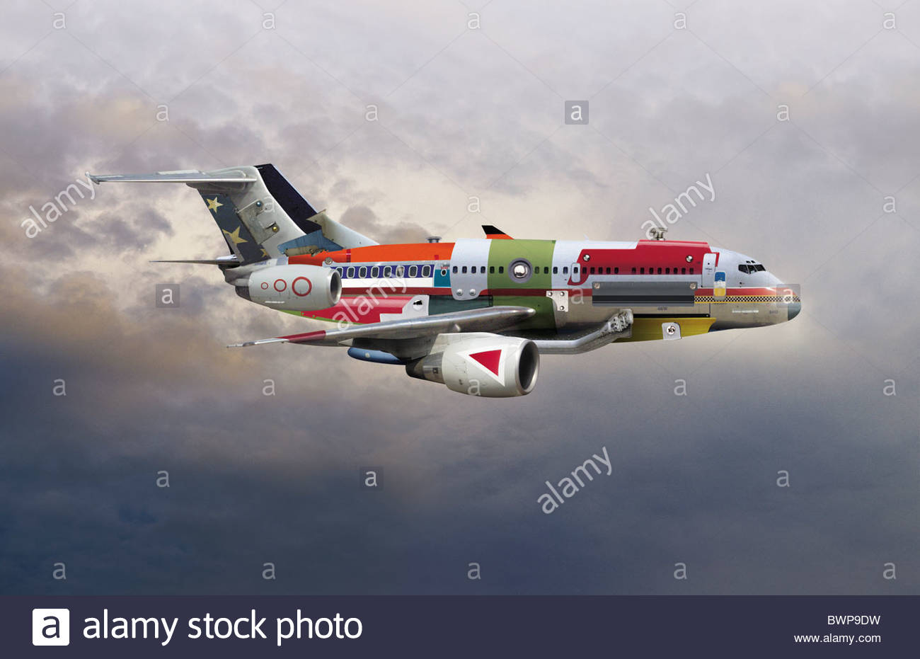 Logo covered airplane flying through the sky - Stock Image