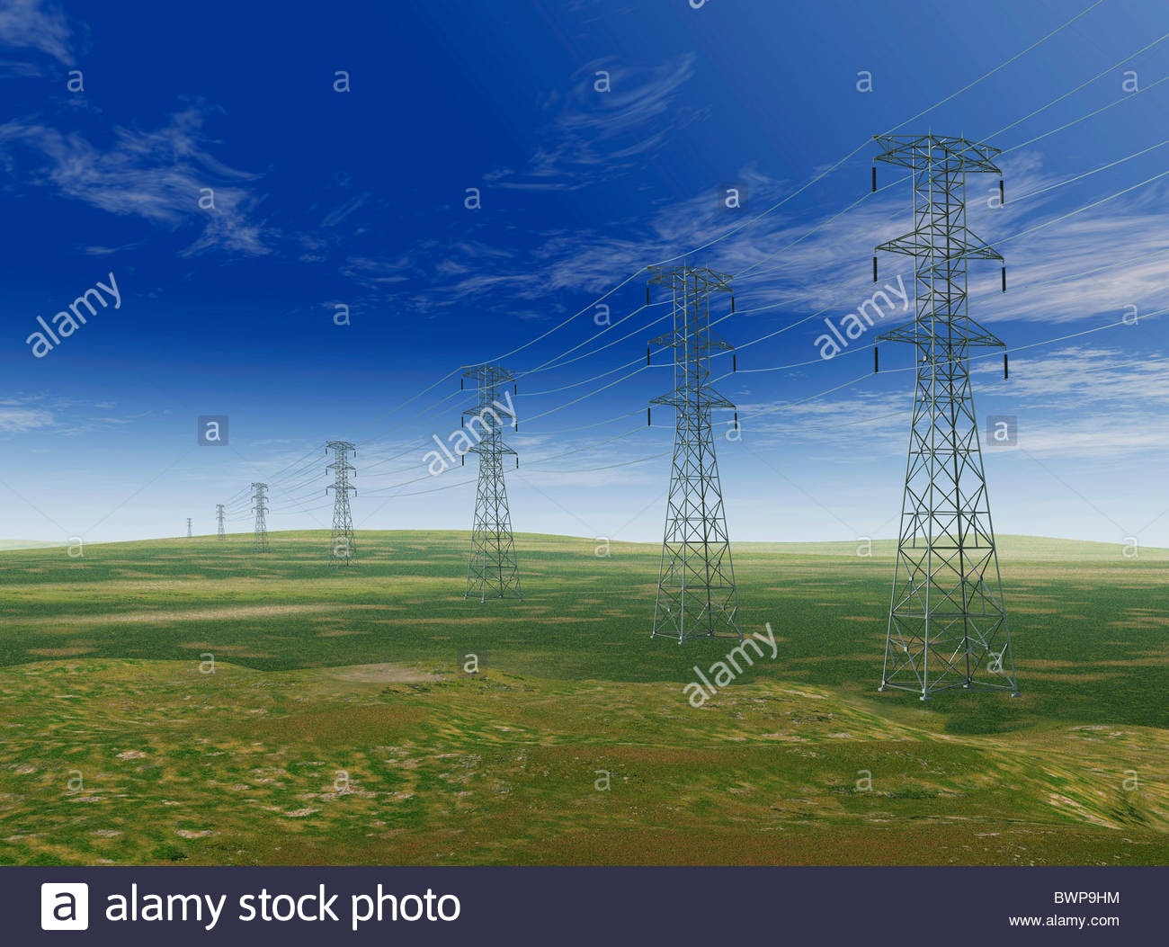 Electricity pylons in remote field - Stock Image