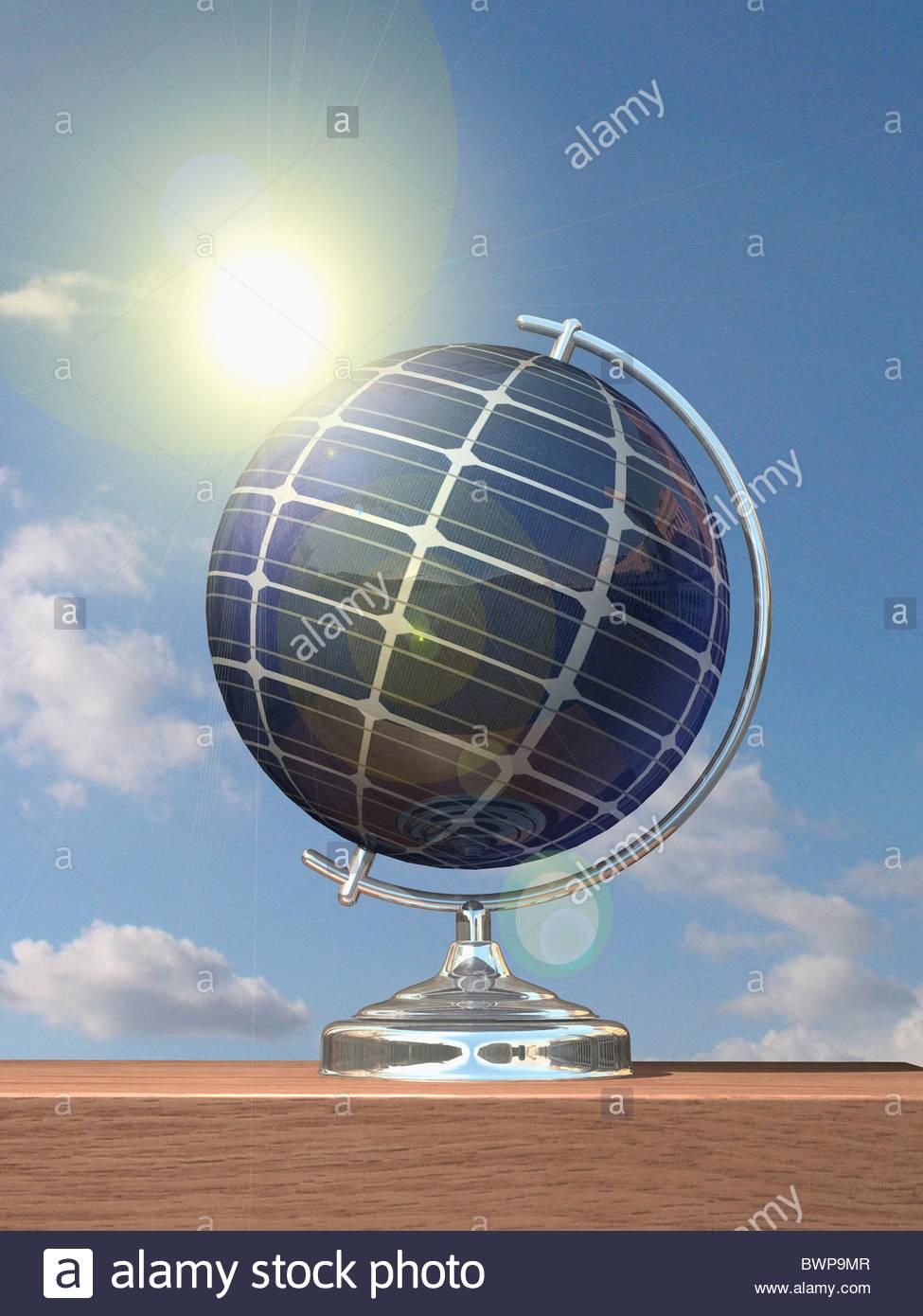 Sun shining on globe covered in solar panels - Stock Image