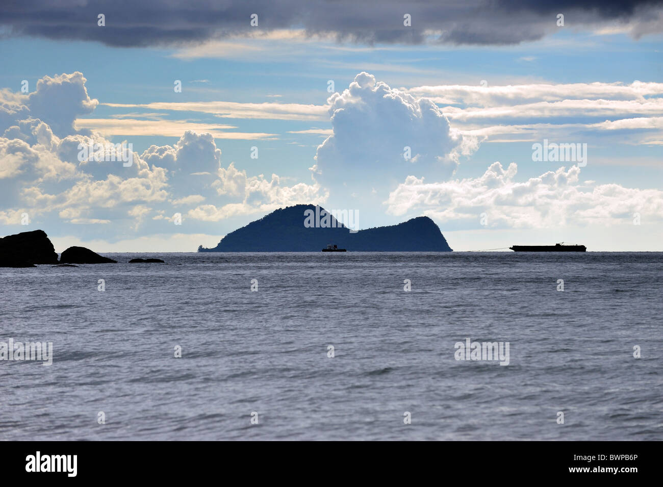 Satang Island with shipping passing by on the South China Sea, Sarawak, Malaysia, Asia - Stock Image