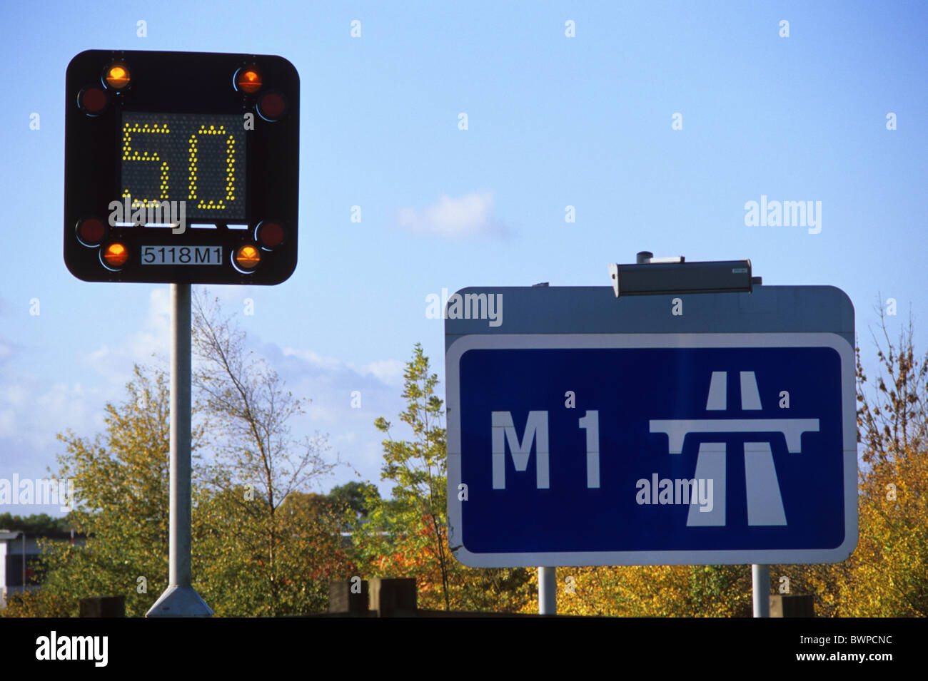 flashing warning sign of reduced speed limit on M1 motorway due to congestion near Leeds Yorkshire UK Stock Photo