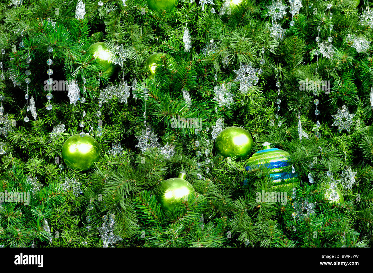 Decorated Christmas tree abstract green background - Stock Image