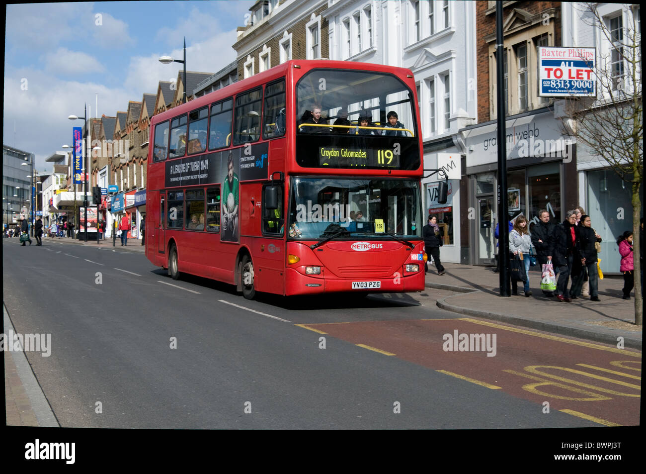A red London double bus operated by Metrobus, part of the Go-Ahead group, travels along Bromley High Street - Stock Image