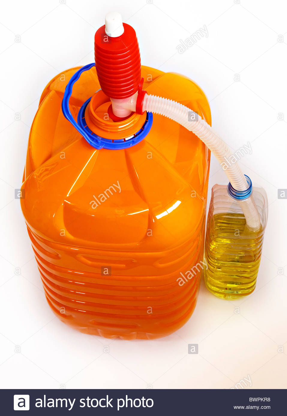 Siphon with plastic hose and paraffin bottle - Stock Image