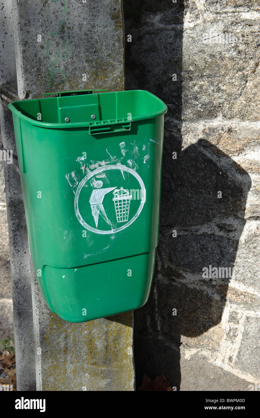 Vandalized public trash can in Portugal - Stock Image