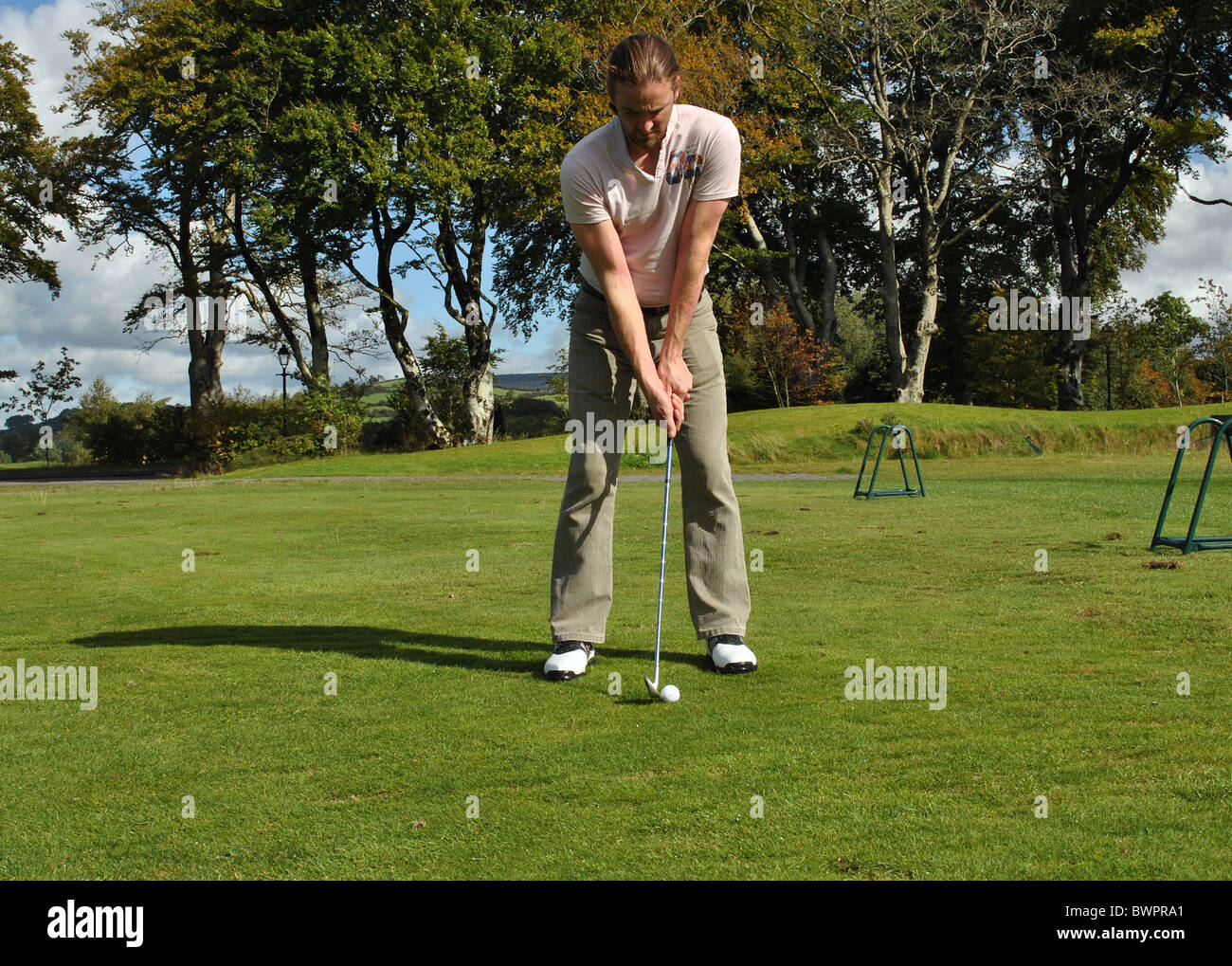 practicing in a driving range - Stock Image